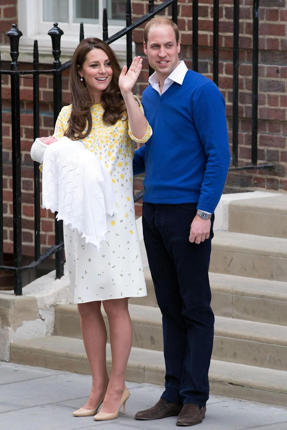 <p>Welcoming Princess Charlotte to the public, Kate chose a bespoke Jenny Packham dress complete with a sweet buttercup print. She paired the look with nude Jimmy Choo pumps. </p><p><i>[Photo: PA]</i></p>