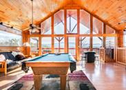"<p>What's a cabin without a hot tub? Okay fine, it's not essential, but for fall and winter lodgings, the option to soak outdoors sure is a nice extra to have. And this one comes with a view of the Smoky Mountains. This two-bedroom would be the perfect stay for a couple of couples in need of a relaxing weekend in the mountains. Knotty pine ceilings, a pool table, king-sized beds, soaking tubs, and commodious leather furniture have a homey, cushy vibe.</p> <p><strong>Book now:</strong> <a href=""https://airbnb.pvxt.net/vRz5j"" rel=""nofollow noopener"" target=""_blank"" data-ylk=""slk:From $196, airbnb.com"" class=""link rapid-noclick-resp"">From $196, airbnb.com</a></p>"