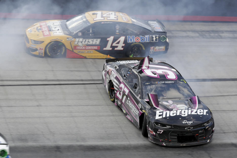 Ryan Preece (37) spins past Clint Bowyer (14) after a cash during a NASCAR All-Star Open auto race at Bristol Motor Speedway in Bristol, Tenn, Wednesday, July 15, 2020. (AP Photo/Mark Humphrey)