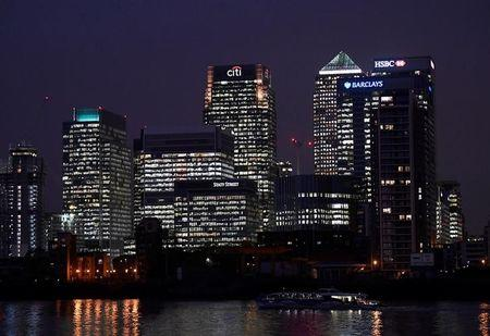 FILE PHOTO - Office blocks of Citi, Barclays, and HSBC banks are seen at dusk in the Canary Wharf financial district in London, Britain November 16, 2017. REUTERS/Toby Melville