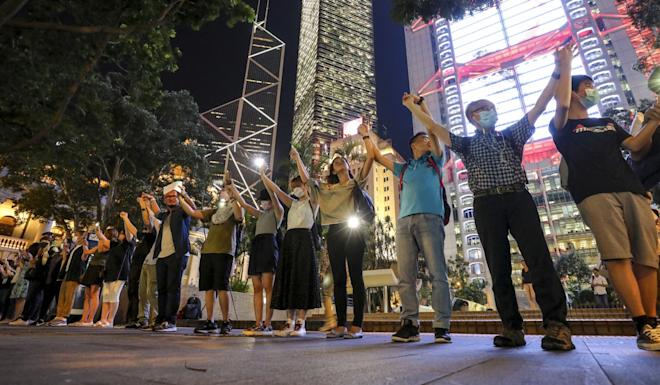 Demonstrators link hands as they gather at Central in Hong Kong on Friday. Photo: Dickson Lee