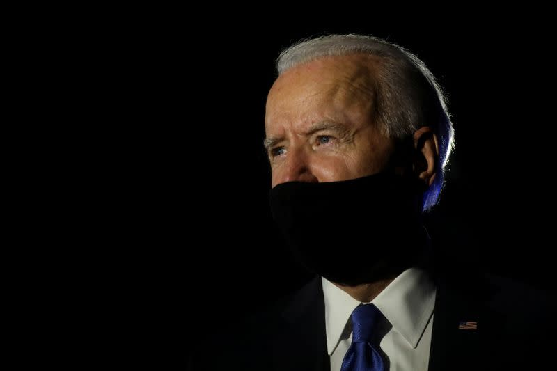 U.S. Democratic presidential candidate Joe Biden looks on as he talks to reporters while leaving, following the final 2020 U.S. presidential campaign debate, at Nashville International Airport in Nashville