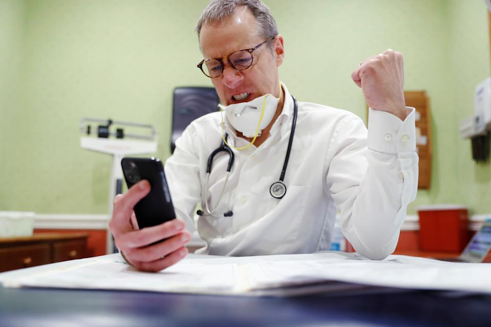 Dr Greg Gulbransen takes part in a telemedicine call with a patient while maintaining visits with both his regular patients and those confirmed to have the coronavirus disease (COVID-19) at his pediatric practice in Oyster Bay, New York, U.S., April 13, 2020.  Picture taken April 13, 2020. REUTERS/Lucas Jackson