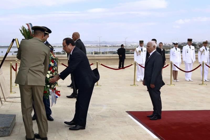 French President Francois Hollande lays a wreath at the martyrs mausoleum in Sijoumi in Tunis, Tunisia on Friday, July 5, 2013. Hollande's two-day visit is an effort to restart relations with Tunisia that were strained from his predecessor's close ties to Zine Abidine Ben Ali, the dictator Tunisians deposed in January 2011. The Tunisian revolution sparked the Arab Spring pro-democracy uprisings across the region, including Egypt. (AP Photo/Pool, Anis Mili)