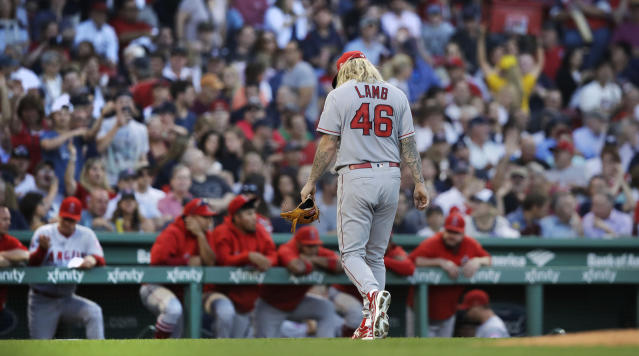 Los Angeles Angels starting pitcher John Lamb leaves the field after getting pulled during the second inning of the team's baseball game against the Boston Red Sox at Fenway Park in Boston, Tuesday, June 26, 2018. (AP Photo/Charles Krupa)