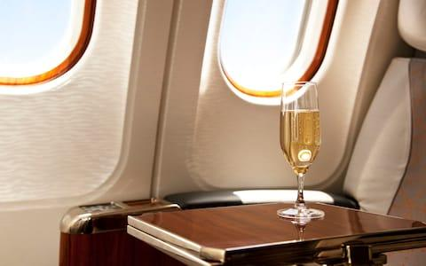 Free-flowing alcohol has long been a fixture of long-haul flying - whatever class you're in - Credit: istock
