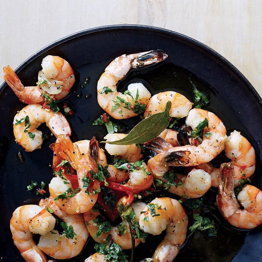 """Shrimp is the <a href=""""http://www.epicurious.com/expert-advice/5-ingredients-for-cooking-easier-faster-article?mbid=synd_yahoo_rss"""" rel=""""nofollow noopener"""" target=""""_blank"""" data-ylk=""""slk:weeknight cook's best friend"""" class=""""link rapid-noclick-resp"""">weeknight cook's best friend</a>. You can keep it in the freezer, it cooks in minutes, and it's extremely versatile. Serve this chile-spiked, lemony dish with a loaf of crusty bread and a bottle of chilled white wine. <a href=""""https://www.epicurious.com/recipes/food/views/roasted-shrimp-with-chile-gremolata-51223810?mbid=synd_yahoo_rss"""" rel=""""nofollow noopener"""" target=""""_blank"""" data-ylk=""""slk:See recipe."""" class=""""link rapid-noclick-resp"""">See recipe.</a>"""