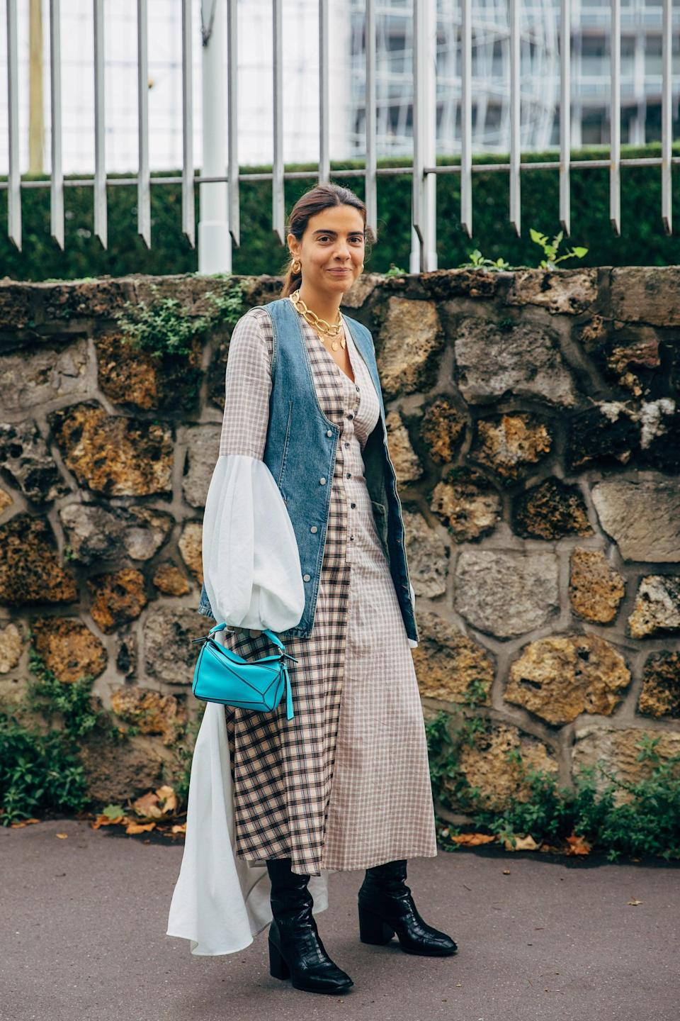 <p>Reinvent a dress you've worn on repeat simply by tossing on a vest. </p>