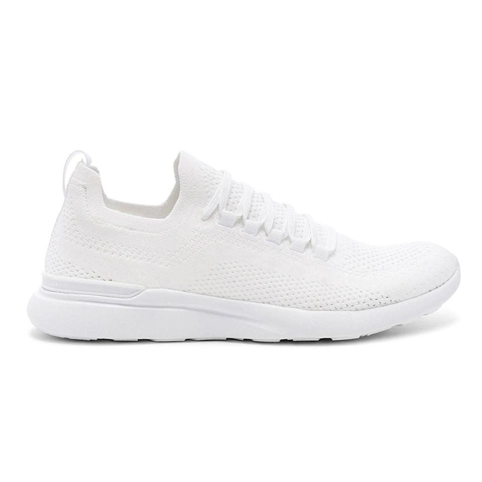 """If you're looking for an everyday sneaker that can easily transition into a lightweight training or <a href=""""https://www.glamour.com/gallery/best-running-shoes-for-women?mbid=synd_yahoo_rss"""" rel=""""nofollow noopener"""" target=""""_blank"""" data-ylk=""""slk:running shoe"""" class=""""link rapid-noclick-resp"""">running shoe</a>, consider your search over. APL's signature material is flexible and the laces are removable, so the sneakers can double as slip-ons or <a href=""""https://www.glamour.com/gallery/best-slippers-for-women?mbid=synd_yahoo_rss"""" rel=""""nofollow noopener"""" target=""""_blank"""" data-ylk=""""slk:slippers"""" class=""""link rapid-noclick-resp"""">slippers</a>—yes, they're that comfortable. $200, Revolve. <a href=""""https://www.revolve.com/apl-athletic-propulsion-labs-techloom-breeze-sneaker-in-white/dp/AHPR-WZ76/?"""" rel=""""nofollow noopener"""" target=""""_blank"""" data-ylk=""""slk:Get it now!"""" class=""""link rapid-noclick-resp"""">Get it now!</a>"""