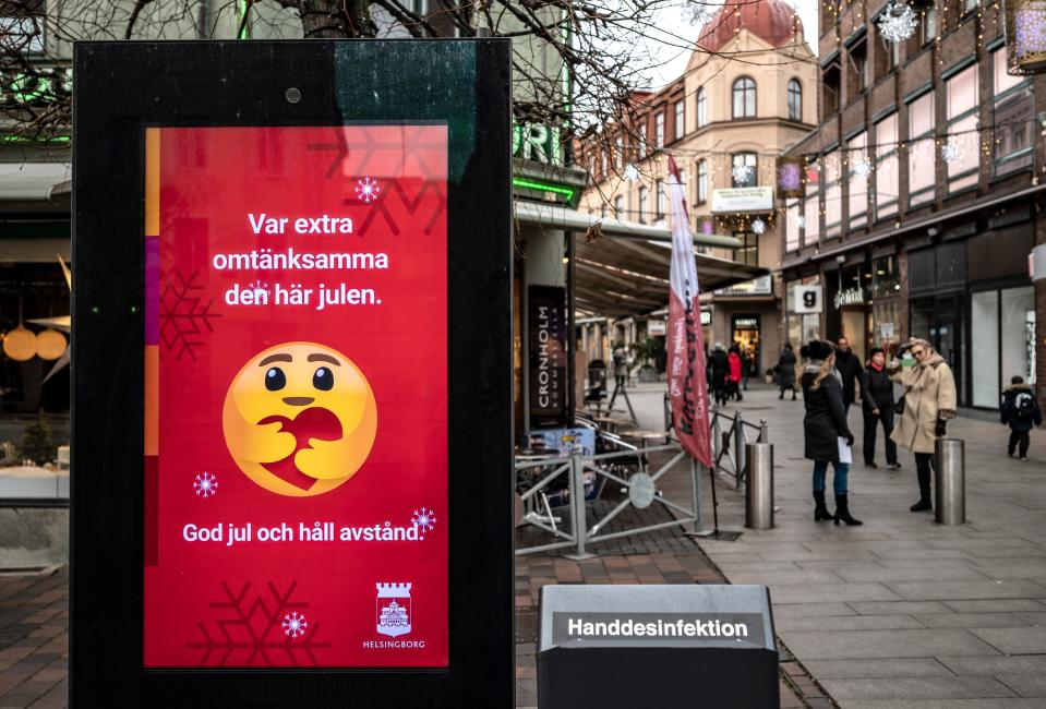 An information sign wishing Merry Christmas and asking to maintain social distancing is seen in a pedestrian shopping street in Helsingborg, southern Sweden, on December 7, 2020. - The last week in November, Helsingborg had more new confirmed Covid-19 cases than in any other city in Sweden. (Photo by Johan NILSSON / TT News Agency / AFP) / Sweden OUT (Photo by JOHAN NILSSON/TT News Agency/AFP via Getty Images)