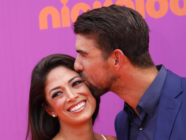 Michael Phelps and his wife Nicole Johnson (Reuters)