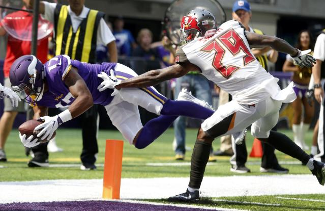 <p>Minnesota Vikings wide receiver Jarius Wright (17) scores on a 2-yard touchdown pass ahead of Tampa Bay Buccaneers cornerback Ryan Smith (29) during the first half of an NFL football game, Sunday, Sept. 24, 2017, in Minneapolis. (AP Photo/Bruce Kluckhohn) </p>