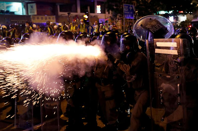 Riot police fire tear gas at anti-extradition demonstrators after a march to call for democratic reforms, in Hong Kong, China July 21, 2019. (Photo: Tyrone Siu/Reuters)