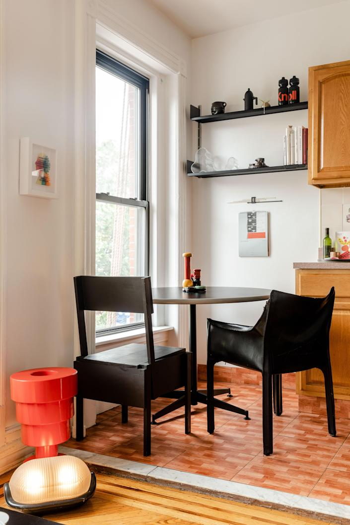 Joshua opted for mismatched black dining chairs in the kitchen.