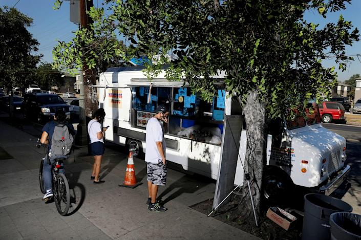 Having food trucks outdoors helped keep Raul Ortega's business, Mariscos Jalisco, alive during the pandemic.