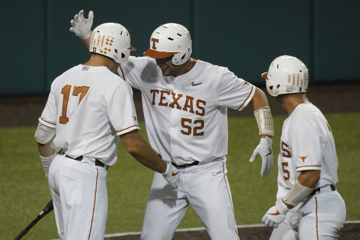 Texas' Zach Zubia (52) celebrates with teammates after hitting a two-run home run against Arizona State in the fourth inning of an NCAA college baseball tournament regional game Saturday, June 5, 2021, in Austin, Texas. (AP Photo/Eric Gay)