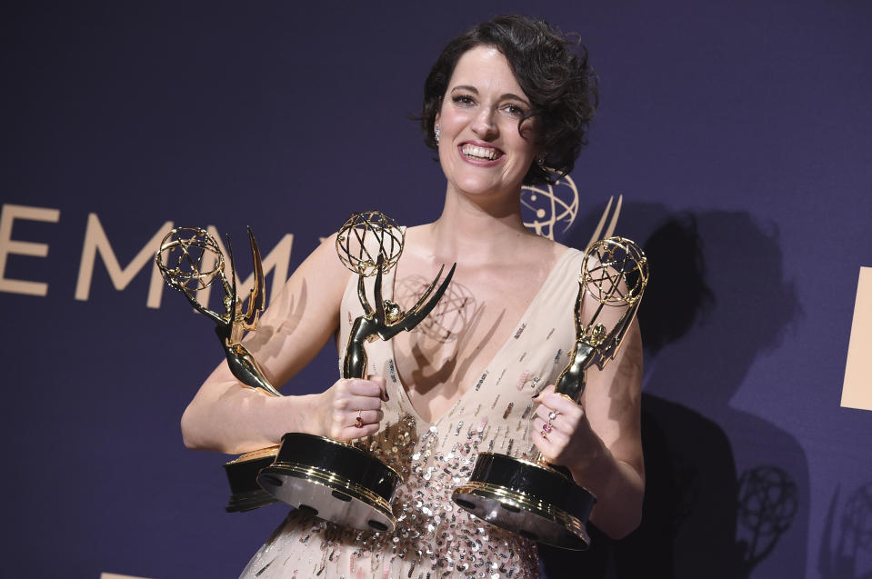 """Phoebe Waller-Bridge, winner of the awards for outstanding lead actress in a comedy series, outstanding comedy series, and outstanding writing for a comedy series for """"Fleabag,"""" poses in the press room at the 71st Primetime Emmy Awards on Sunday, Sept. 22, 2019, at the Microsoft Theater in Los Angeles. (Photo by Jordan Strauss/Invision/AP)"""
