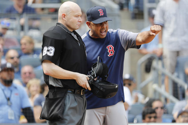 Boston Red Sox manager Alex Cora, left, reacts to umpire Mike Estabrook during a baseball game against the New York Yankees in the fourth inning, Saturday, Aug. 3, 2019, in New York. (AP Photo/Michael Owens)