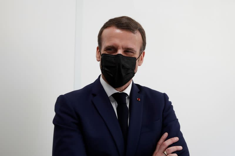 French President Macron visits a coronavirus disease (COVID-19) vaccination center in Bobigny
