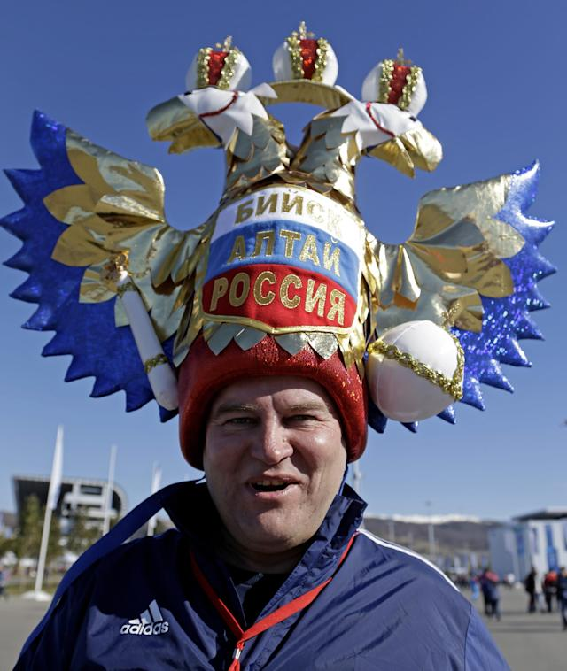 A fan makes his way to the Olympic Park for the 2014 Winter Olympics, Thursday, Feb. 13, 2014, in Sochi, Russia. (AP Photo/Morry Gash)