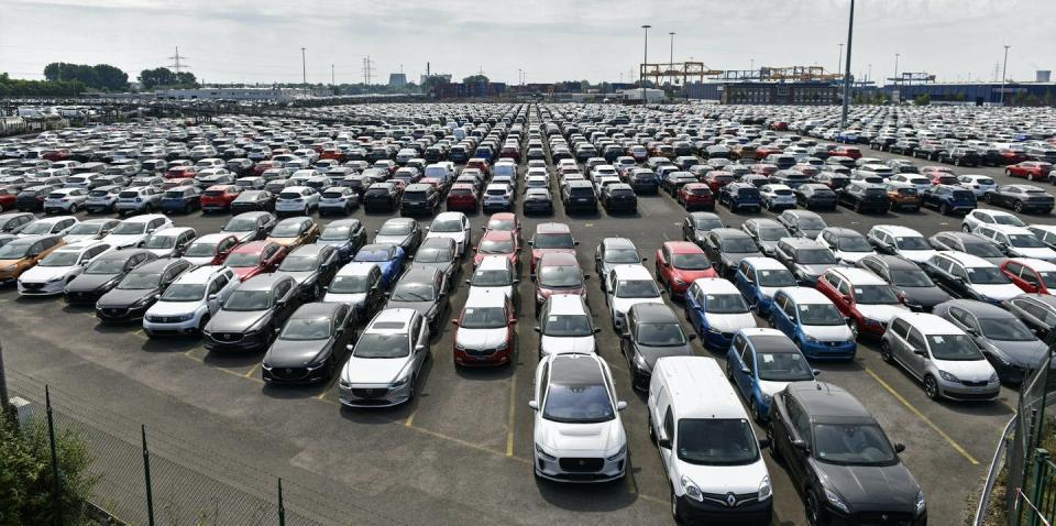 hundreds of cars parked in a lot