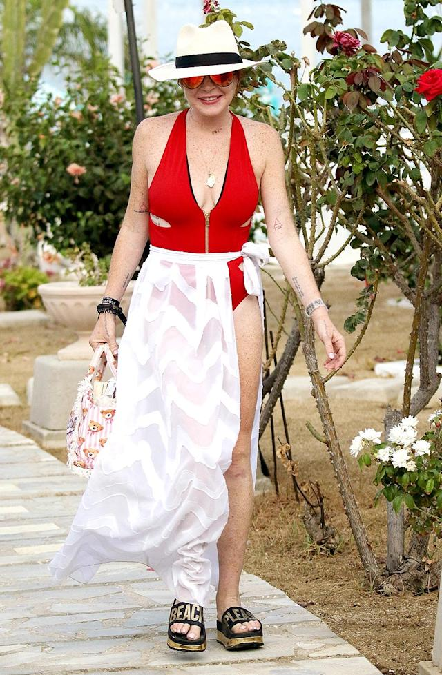 "<p>Lohan was ready to hit the beach in some sandals with a funny message that <a href=""http://www.instyle.com/news/lindsay-lohan-affordable-sandals"" rel=""nofollow noopener"" target=""_blank"" data-ylk=""slk:cost only $30"" class=""link rapid-noclick-resp"">cost only $30</a>. Of course, if you want to re-create the scene, traveling to Mykonos, Greece, where LiLo was, will probably set you back much more. (Photo: BACKGRID) </p>"