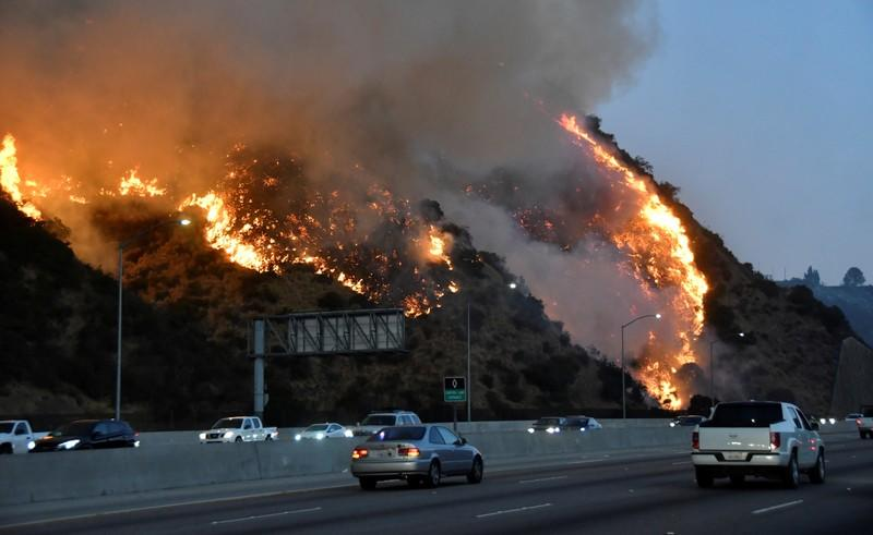 The Getty Fire burns near the Getty Center along the 405 freeway north of Los Angeles, California
