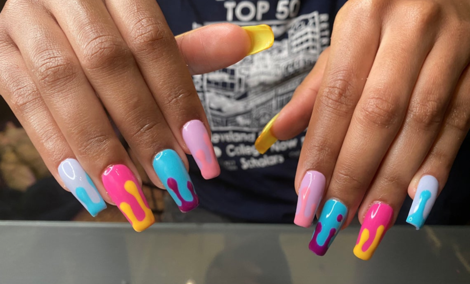 """<p><strong>nailprimo</strong></p><p>etsy.com</p><p><strong>$32.00</strong></p><p><a href=""""https://go.redirectingat.com?id=74968X1596630&url=https%3A%2F%2Fwww.etsy.com%2Flisting%2F784406298%2Fdrippy-handmade-gel-x-press-on-nails-med&sref=https%3A%2F%2Fwww.oprahmag.com%2Fbeauty%2Fskin-makeup%2Fg33239588%2Fhalloween-nail-ideas%2F"""" rel=""""nofollow noopener"""" target=""""_blank"""" data-ylk=""""slk:SHOP NOW"""" class=""""link rapid-noclick-resp"""">SHOP NOW</a></p><p>Looking for a drippy nail design that's not so bloody? Try a fun multicolor one with contrasting combinations that pop. </p>"""