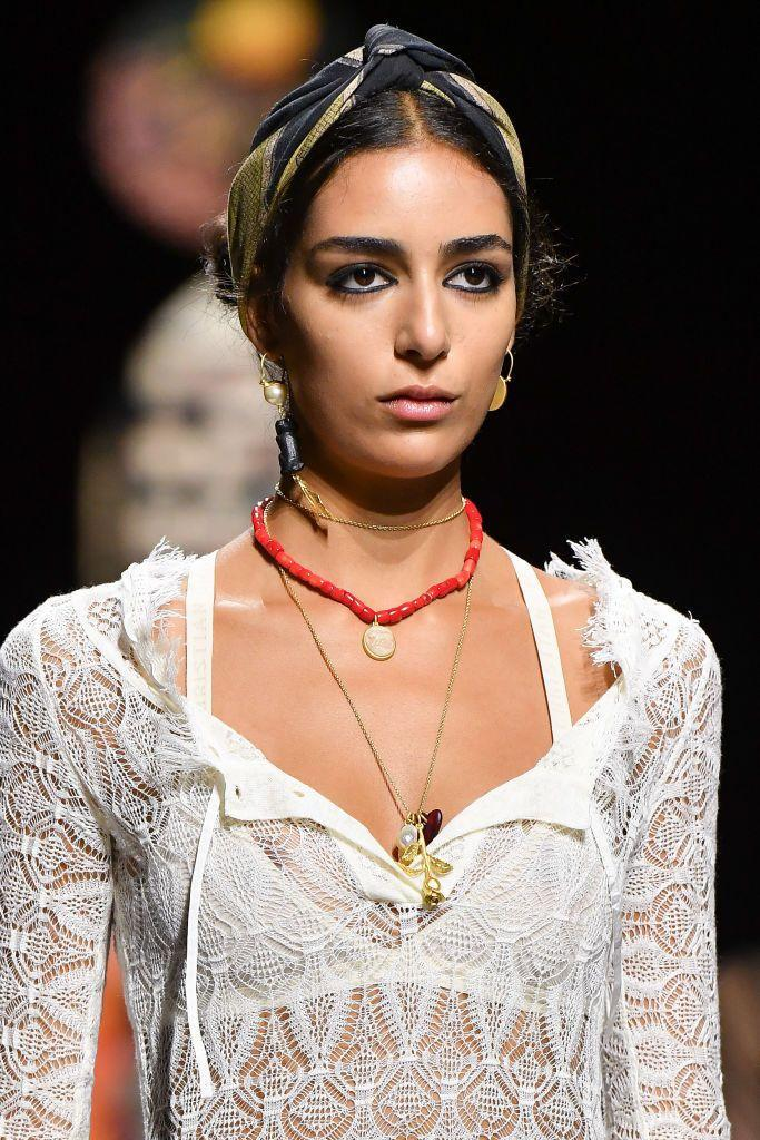 <p>For the summer, try pairing your charm necklace with other colorful pieces. </p><p><em>Dior </em></p>