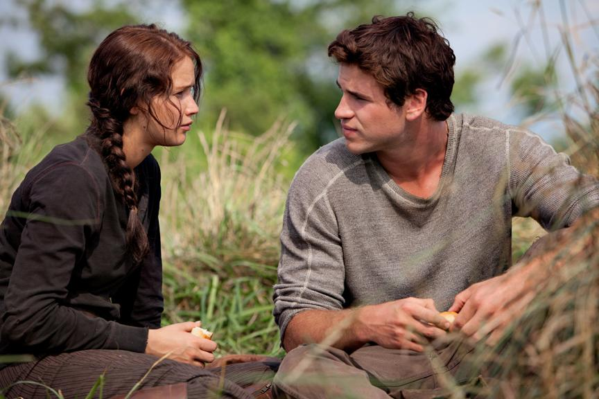 Katniss Everdeen (Jennifer Lawrence) and her hunting pal and best friend from District 12 Gale Hawthorne (Liam Hemsworth).