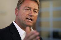 Former U.S. Sen. Dean Heller speaks with the media at an event at Share Village Las Vegas after announcing a bid for governor of Nevada, Monday, Sept. 20, 2021, in Las Vegas. (AP Photo/John Locher)
