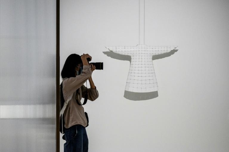 'Braiding' (R) by Chinese artist Ma Xiaojuan is on show at the Hong Kong Museum of Art exhibition