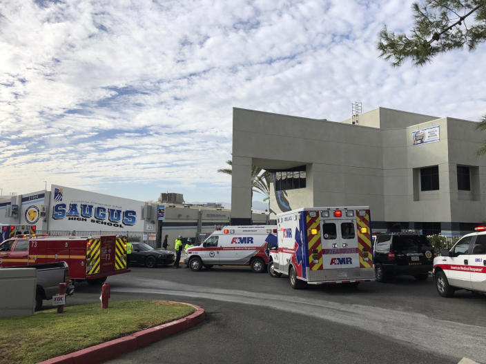 Ambulances are parked outside of Saugus High School after reports of a shooting on Thursday, Nov. 14, 2019 in Santa Clarita, Calif. A few people were injured Thursday during a shooting at the high school, about 30 miles (48 kilometers) northwest of downtown Los Angeles, and a search was underway for the gunman, authorities said. (AP Photo/Marcio Jose Sanchez)