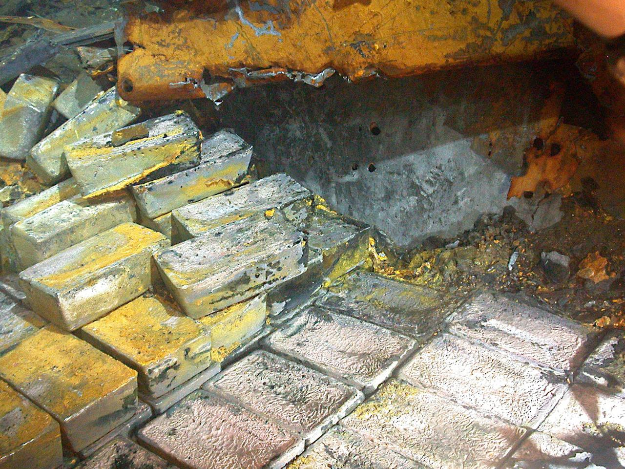 This image taken July 5, 2012 provided by Odyssey Marine, Inc. shows the discovery of silver on the SS Gairsoppa. Forty-eight tons of silver bullion has been recovered from the SS Gairsoppa and returned to the British Government the company announced Wednesday July 18, 2012. The record-breaking operation has so far produced the heaviest and deepest recovery of precious metals from a shipwreck. (AP Photo/Odyssey Marine Inc.)