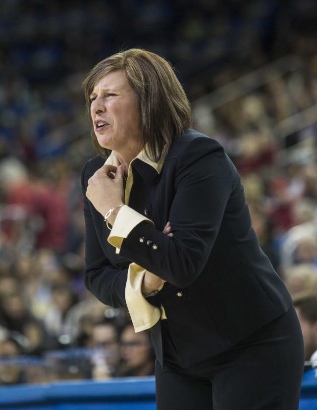 UCLA head coach Cori Close encourages his team against UCLA in the first half of an NCAA college basketball game, Sunday, Feb. 23, 2014 in Los Angeles. (AP Photo/Ringo H.W. Chiu)