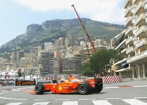 Germany's Michael Schumacher steers his Ferrari out of the tunnel with Monaco in the background during the second timed practice session of the Monaco Grand Prix Thursday, May 21, 1998. Schumacher clocked the fifth fastest time.(AP Photo/Michel Euler)