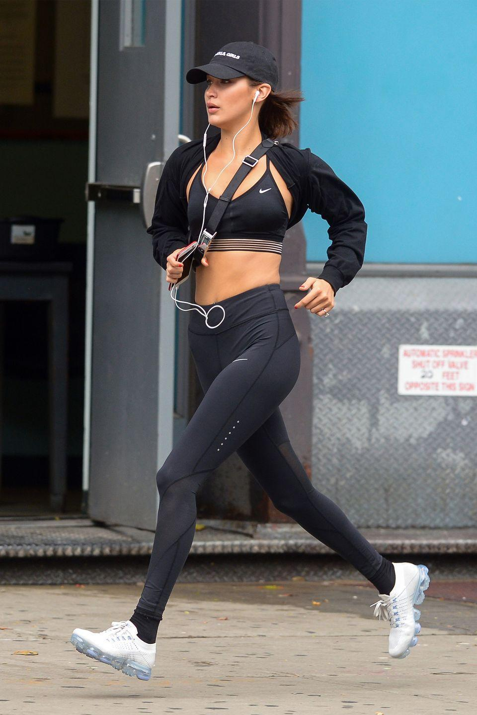 <p>In a Nike sports bra, high-waisted Nike pants and sneakers while on a run in NYC. </p>