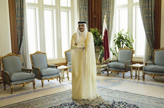 <p>Qatar Emir Sheik Tamim bin Hamad Al-Thani waits for the arrival of U.S. Secretary of State John Kerry ahead of their meeting, at Diwan Palace in Doha, Qatar on Aug. 3, 2015. Four Arab nations have cut ties with Qatar over an escalating diplomatic battle over the country's backing of Islamist groups and its relations with Iran. (Photo: Brendan Smialowski/Pool Photo via AP) </p>