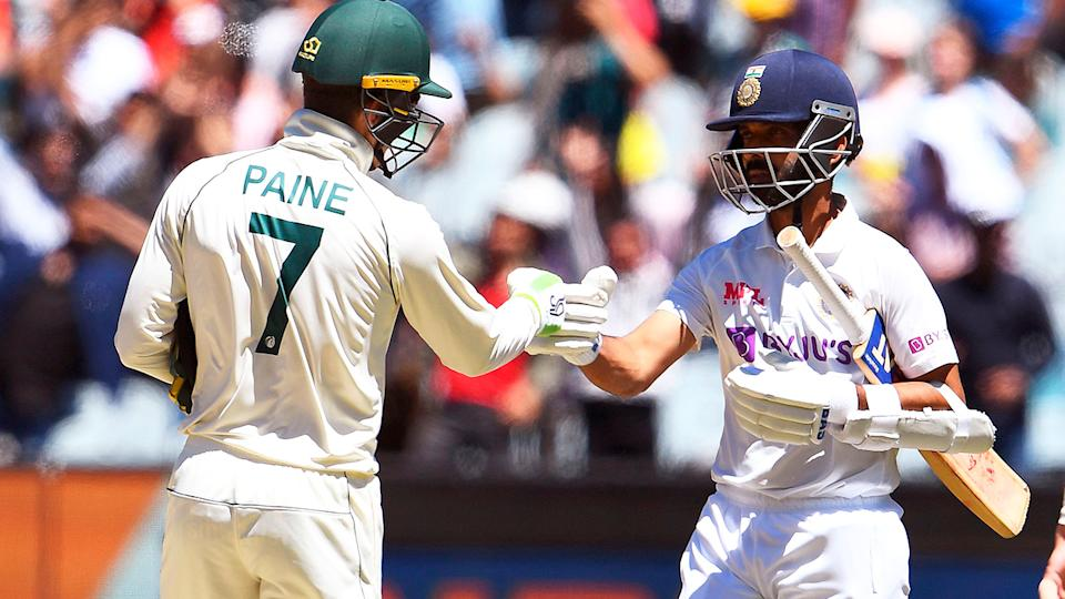 India's captain Ajinkya Rahane (pictured right) bumps fists with Australia's captain Tim Paine (pictured left).