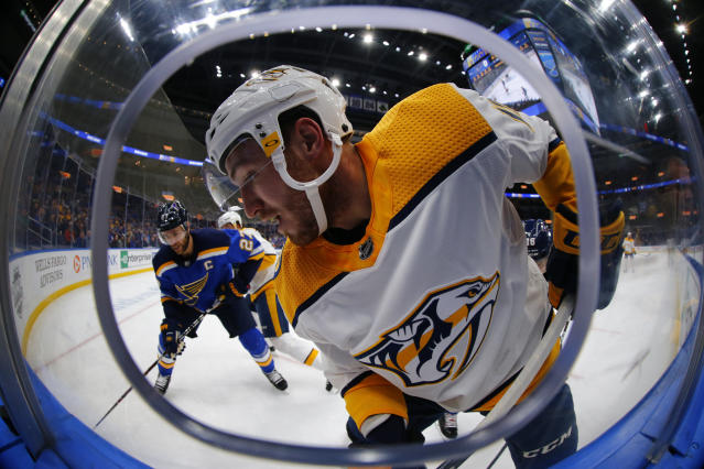Nashville Predators' Colton Sissons attempts to control the puck against St. Louis Blues' Alex Pietrangelo (27) during the first period of an NHL hockey game Tuesday, Feb. 26, 2019, in St. Louis. (AP Photo/Dilip Vishwanat)
