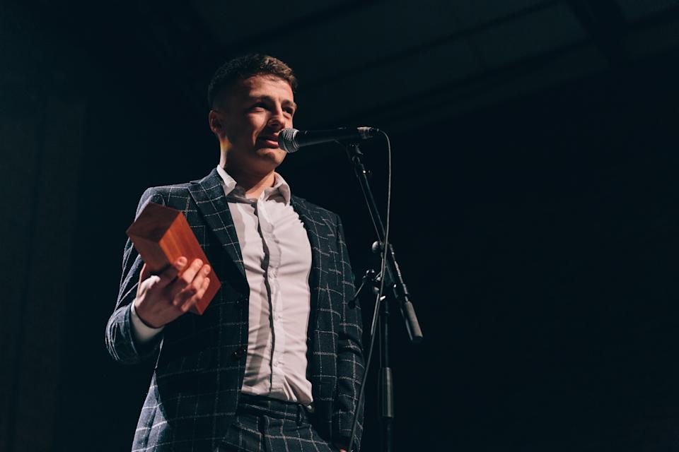 Stewart Morgan was diagnosed with testicular cancer four days after his 21st birthday. He is pictured receiving the 'Know Thy Nuts' award at the 2019 Movember ceremony. (Supplied: Movember)