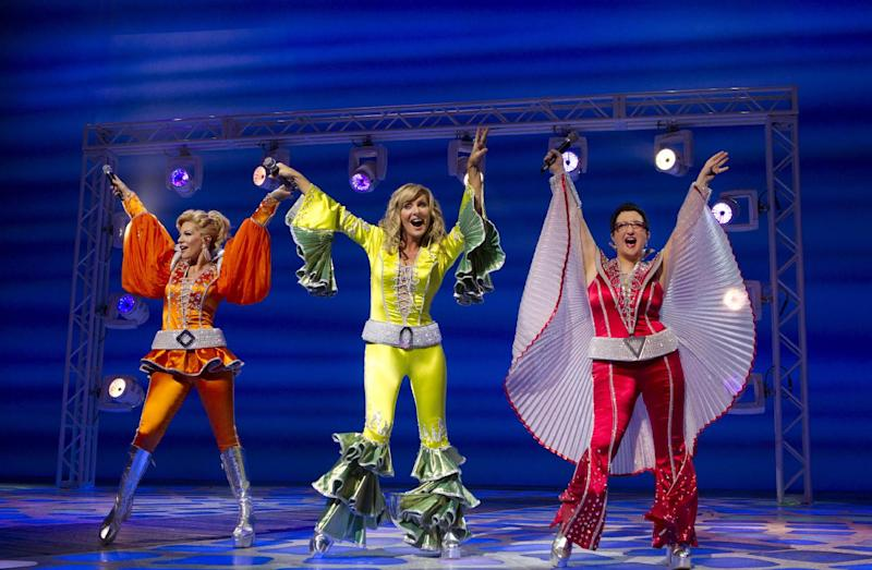 "This photo provided by Boneau/Bryan-Brown shows from left, Felicia Finley, Judy McLane and Lauren Cohn in Benny Andersson and Bjorn Ulvaeus' global smash hit musical, ""Mamma Mia!"" on Broadway at the Winter Garden Theatre. The beloved musical ""Mamma Mia!"" moves from the Winter Garden, its home of 12 years, to a new location six blocks south at the Broadhurst Theatre. (AP Photo/Boneau/Bryan-Brown, Joan Marcus)"