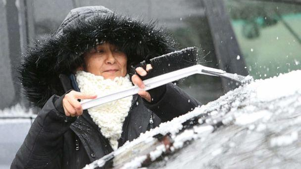 PHOTO: Aura Rodriguez clears the ice from her car in Beacon, N.Y., Dec. 17, 2019. (Patrick Oehler/Poughkeepsie Journal via USA Today)