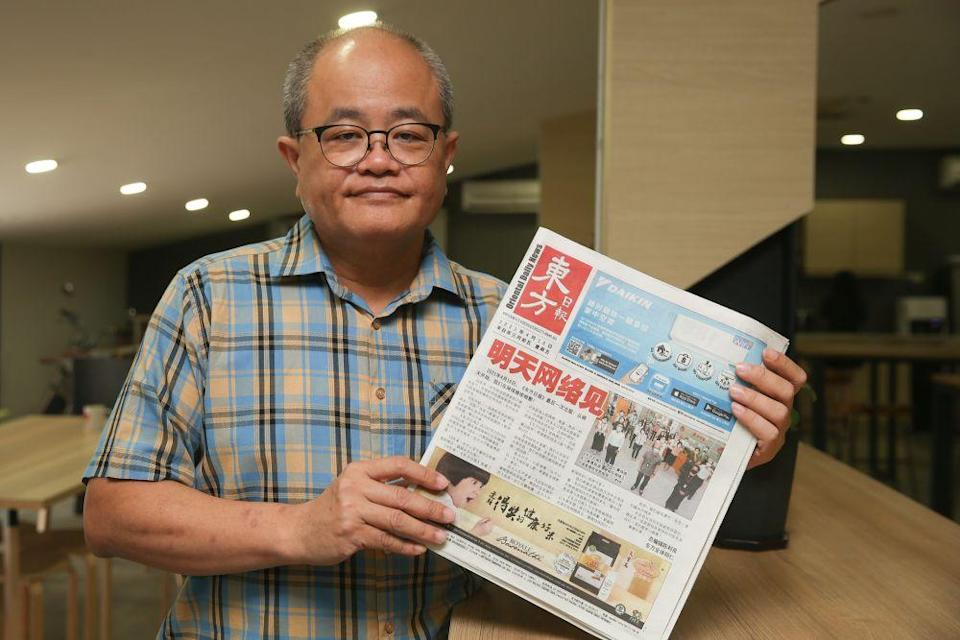 Editor-in-chief of Oriental Daily Ding Lee Leong holds up a copy of the final edition of the newspaper during an interview with Malay Mail in Petaling Jaya April 16, 2021. — Picture by Choo Choy May