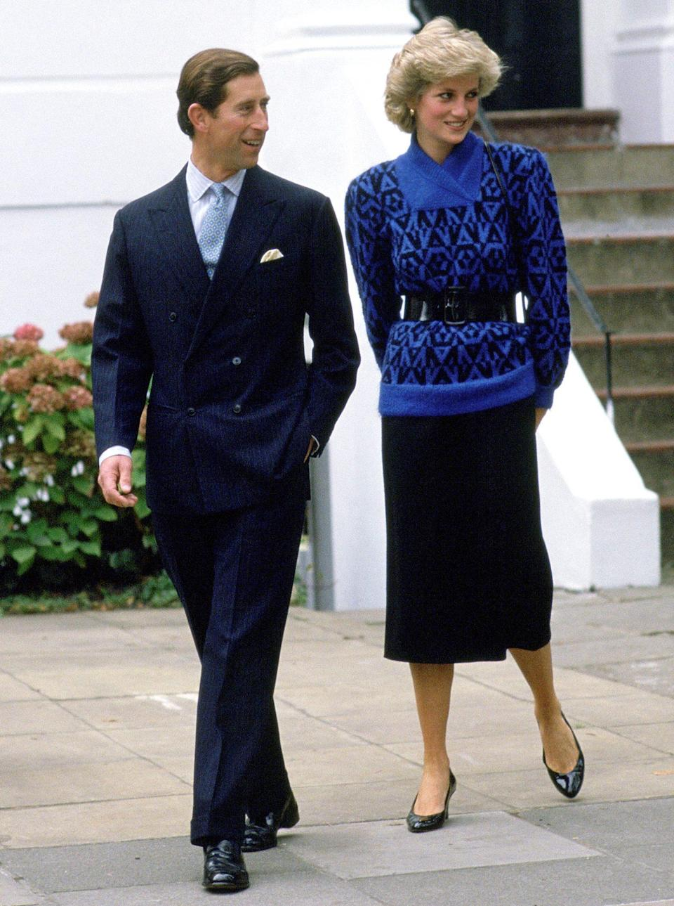 <p>During a school run for son Prince William, Diana opted for a blue patterned pullover that she cinched at the waist with a wide belt.</p>