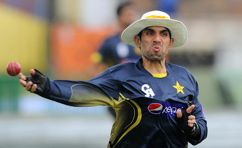 Pakistan team captain Misbah-ul-Haq throws a ball during a practice session at the Galle International Cricket Stadium in Galle on August 5, 2014
