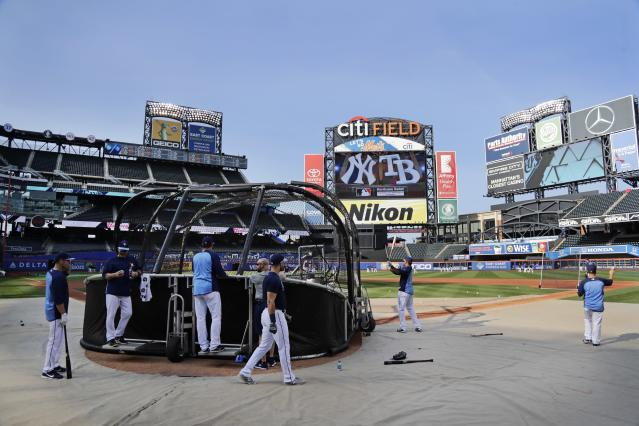 Tampa Bay Rays players warm up at Citi Field before a baseball game against the New York Yankees, Monday, Sept. 11, 2017, in New York. The Yankees will be the visiting team for the series moved from St. Petersburg, Florida, because of Hurricane Irma. (AP Photo/Frank Franklin II)
