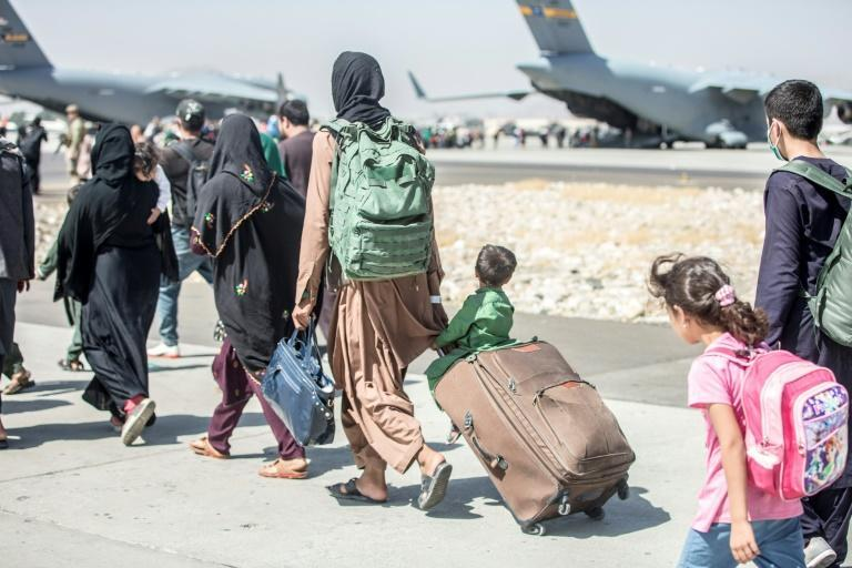 People are evacuated at Hamid Karzai International Airport in Kabul on August 24, 2021