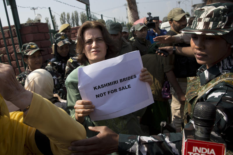 Safia Abdullah, daughter of Jammu and Kashmir National Conference leader Farooq Abdullah, holds a placard during a protest in Srinagar, Indian controlled Kashmir, Tuesday, Oct. 15, 2019. A small group of women under the banner of 'Women of Kashmir', a civil society group had gathered for a peaceful protest to condemn Indian government downgrading the region's semi-autonomy and demanded restoration of civil liberties and fundamental rights of citizens. (AP Photo/Dar Yasin)