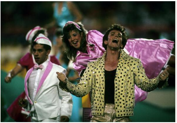 """<div class=""""caption-credit""""> Photo by: Getty Images/Rob Brown</div><div class=""""caption-title""""></div>In 1989, impersonator Elvis Presto gave a crazy-kitsch performance in Miami. The former Solid Gold dancer wore belly-high gold lame pants and a studded jacket, and he and did a card trick."""